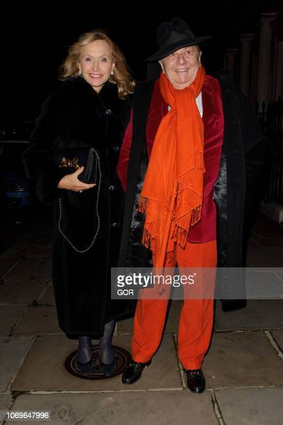 Barry Humphries and Lizzie Spender seen attending the Evgeny Lebedev Christmas Party in North London on December 7 2018 in London England