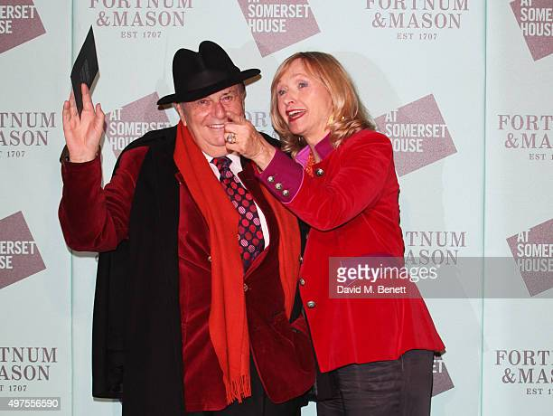 Barry Humphries and wife Lizzie Spender attend the opening party of Skate at Somerset House with Fortnum Mason at Somerset House on November 17 2015...