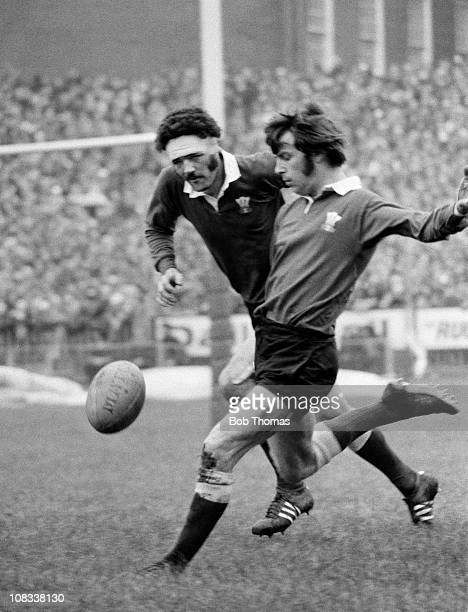 Barry John of Wales kicks watched by Mervyn Davies during the match against Scotland during the Five Nations rugby union championship in Cardiff on...