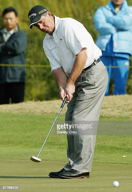 Barry Lane of England putts on the 7th hole during the Final Round of the Volvo China Open held at the Silport Golf Club on November 28, 2004 in...