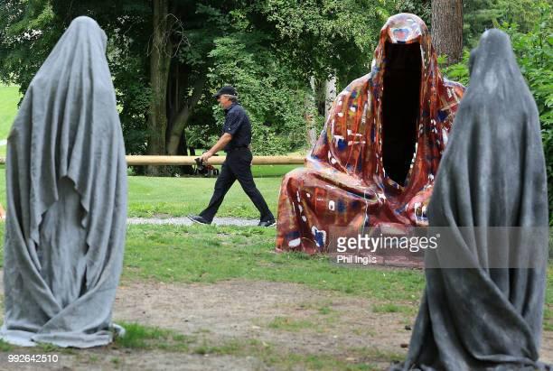 Barry Lane of England walks past some statues on course during Day One of the Swiss Seniors Open at Golf Club Bad Ragaz on July 6, 2018 in Bad Ragaz,...