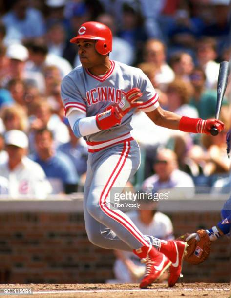 Barry Larkin of the Cincinnati Reds bats during an MLB game against the Chicago Cubs at Wrigley Field in Chicago Illinois during the 1990 season