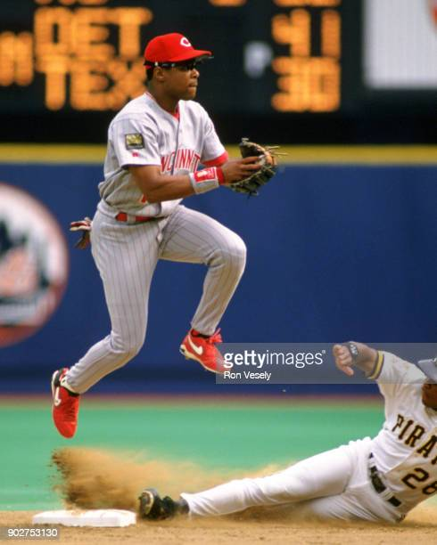 Barry Larkin of the Cincinnati Reds fields during an MLB game versus the Pittsburgh Pirates at Three Rivers Stadium in Pittsburgh Pennsylvania during...