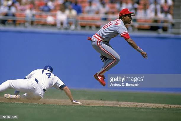 Barry Larkin of the Cincinnati Reds leaps to make a double play during a 1988 season game Barry Larkin played for the Cincinnati Reds from 19862004