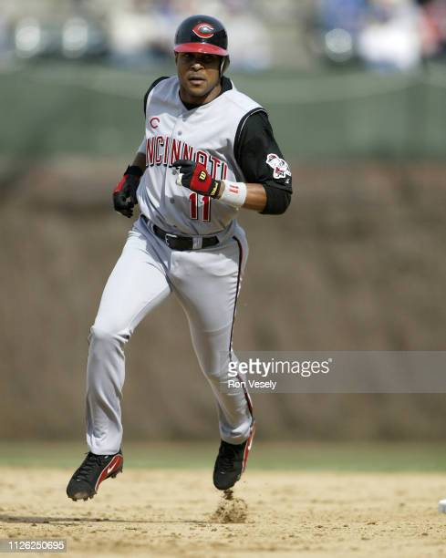 Barry Larkin of the Cincinnati Reds runs toward third base during a MLB game at Wrigley Field in Chicago Illinois Larkin played for the Cincinnati...