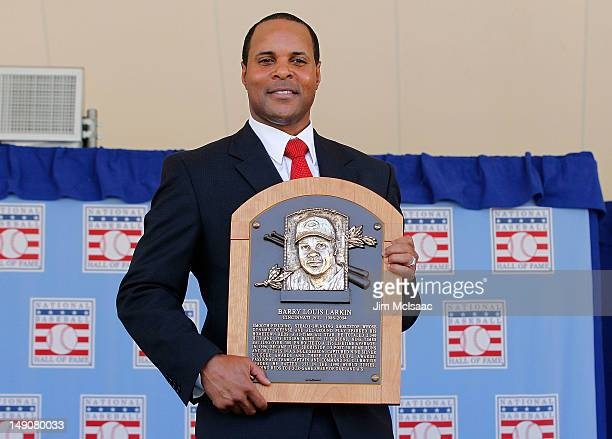 Barry Larkin poses for a photograph with his plaque at Clark Sports Center during the Baseball Hall of Fame induction ceremony on July 22 2012 in...