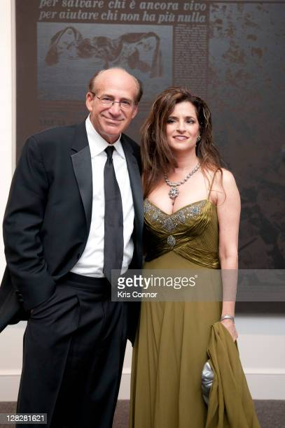 Barry Levine and MariaElena Tierno pose for a photo during the Warhol Headlines exhibition opening in the East Building at the National Gallery of...