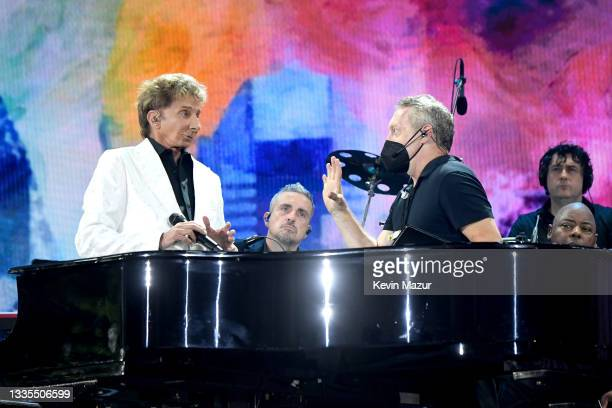 Barry Manilow is interrupted while performing onstage during We Love NYC: The Homecoming Concert Produced by NYC, Clive Davis, and Live Nation, as it...