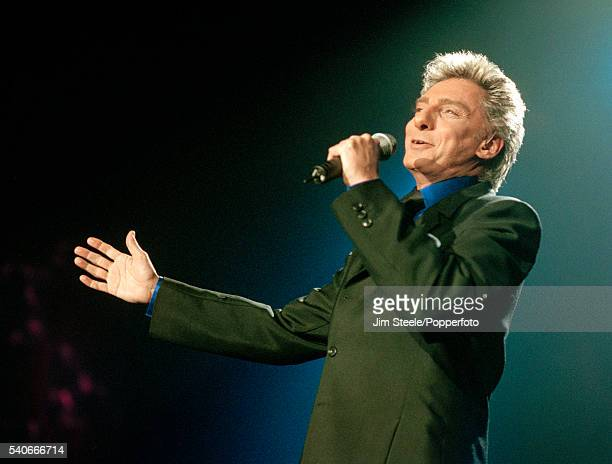 Barry Manilow performing on stage at Wembley Arena in London on the 22nd January, 1998.