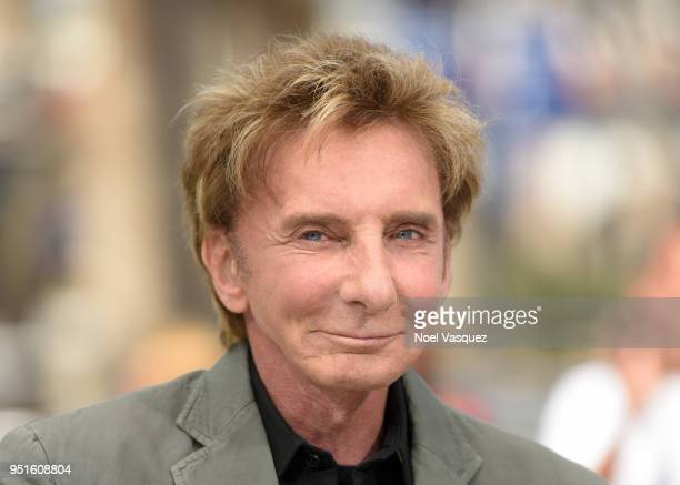Barry Manilow visits 'Extra' at Universal Studios Hollywood on April 26 2018 in Universal City California