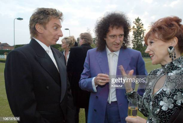 Barry Manilow with Brian May and Anita Dobson Barry Manilow chose to wear the black and white diamond watch from the Elton John watch collection by...