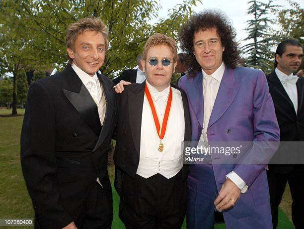 Barry Manilow with Sir Elton John and Brian May Barry Manilow chose to wear the black and white diamond watch from the Elton John watch collection by...