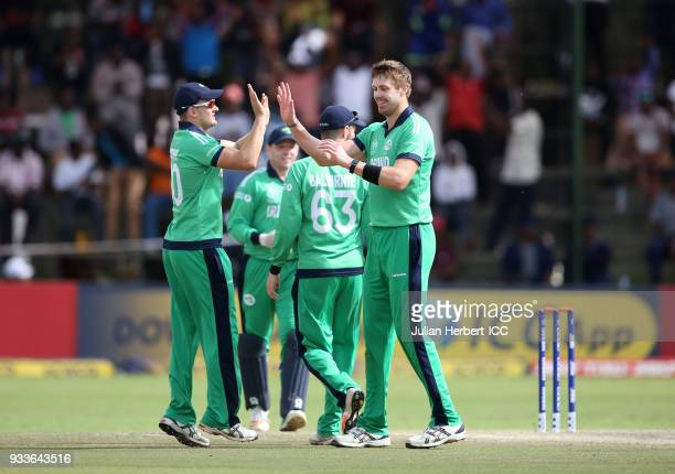 Barry McCarthy of Ireland congratulates Boyd Rankin after he took the wicket of Craig Wallace of Scotland during The Cricket World Cup Qualifier...