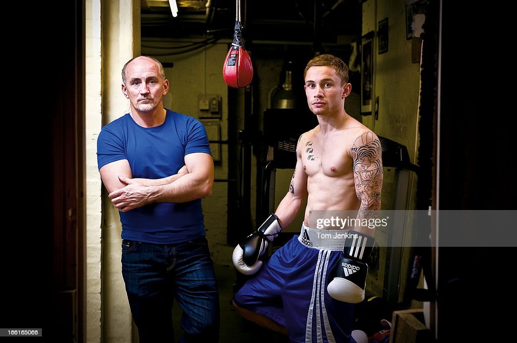 Barry McGuigan (left), the former World featherweight champion, who now manages and trains Carl Frampton (right), a super-bantamweight fighter from Belfast, pose for a portrait in the basement gym at McGuigan's house near Faversham, Kent May 31st 2011(Photo by Tom Jenkins/Getty Images). An image from the book 'In The Moment' published June 2012