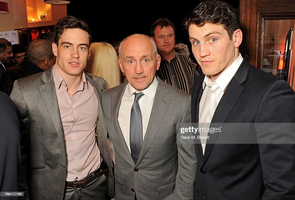 Barry McGuigan (C) with sons Jake and Shane attend 'A Night of Sporting Gold' hosted by bespoke tailor Apsley at their Pall Mall showroom on May 9, 2013 in London, England.