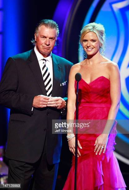Barry Melrose and Kathryn Tappan of the NHL Network address the audience during the 2012 NHL Awards at the Encore Theater at the Wynn Las Vegas on...