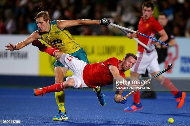 TOPSHOT Barry Middleton of England is tackled by Australia's Daniel Beale during their men's field hockey final match of the 2018 Sultan Azlan Shah...