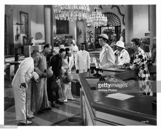 Barry Nelson and Keye Luke are given a Chinese welcome upon their arrival in Rangoon in a scene from the film 'A Yank On The Burma Road', 1942.
