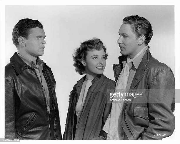 Barry Nelson and Laraine Day looking at Stuart Crawford in a scene from the film 'A Yank On The Burma Road' 1942
