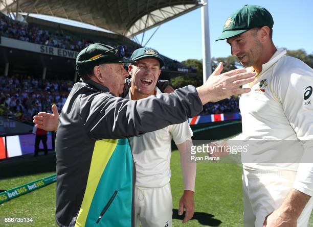 Barry 'Nugget' Rees celebrates victory with David Warner and Shaun Marsh of Australia during day five of the Second Test match during the 2017/18...