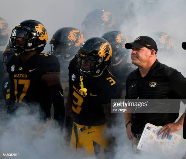 Barry Odom head coach of the Missouri Tigers waits with his team as the prepare to take to the field prior to a game against the South Carolina...