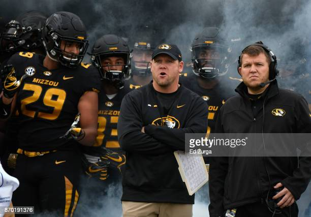 Barry Odom head coach of the Missouri Tigers waits with members of his team as they wait to take to the field for a game against the Florida Gators...