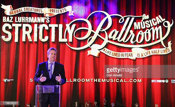 Barry O'Farrell addresses the media during the photo call for 'Strictly Ballroom The Musical' at Town Hall on August 5 2013 in Sydney Australia
