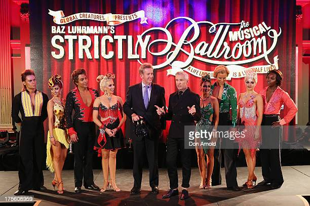 Barry O'Farrell and Baz Luhrmann pose alongside performers during the photo call for 'Strictly Ballroom The Musical' at Town Hall on August 5 2013 in...