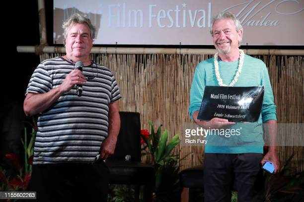 Barry Rivers presents Louie Schwartzberg with The Visionary Award at the 2019 Maui Film Festival on June 12 2019 in Wailea Hawaii