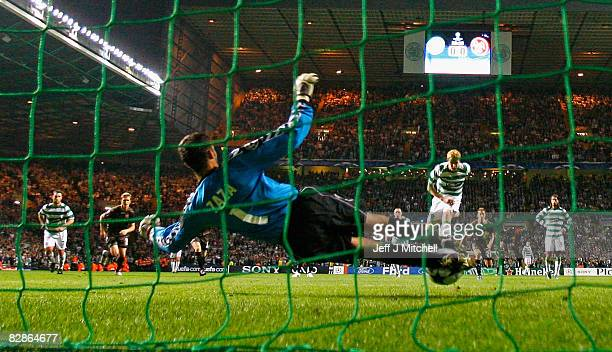 Barry Robson of Celtic has a shot on goal during the UEFA Champions League Group E match between Celtic and Aalborg at Celtic Park on September 17...