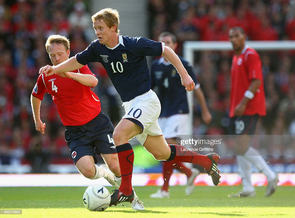 Barry Robson of Scotland battles with Fredrik Winsnes of Norway during the FIFA 2010 World Cup Qualifying Match between Scotland and Norway at Hampden Park on October 11, 2008 in Glasgow, Scotland.