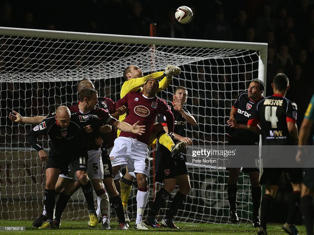 Barry Roche of Morecambe attempts to punch the ball clear under pressure from Clive Platt of Northampton Town during the npower League Two match between Northampton Town and Morecambe at Sixfields Stadium on November 20, 2012 in Northampton, England.