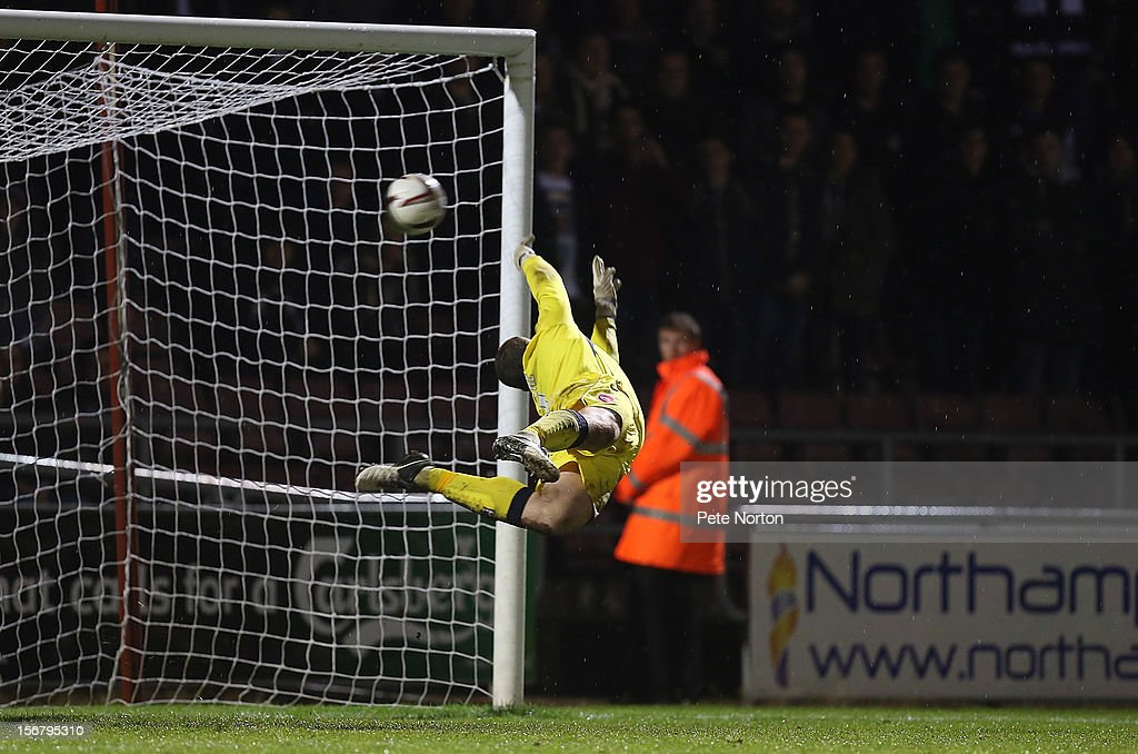 Barry Roche of Morecambe is beaten by a free kick taken by Ishmel Demontagnac of Northampton Town for Northampton's 3rd goal during the npower League Two match between Northampton Town and Morecambe at Sixfields Stadium on November 20, 2012 in Northampton, England.