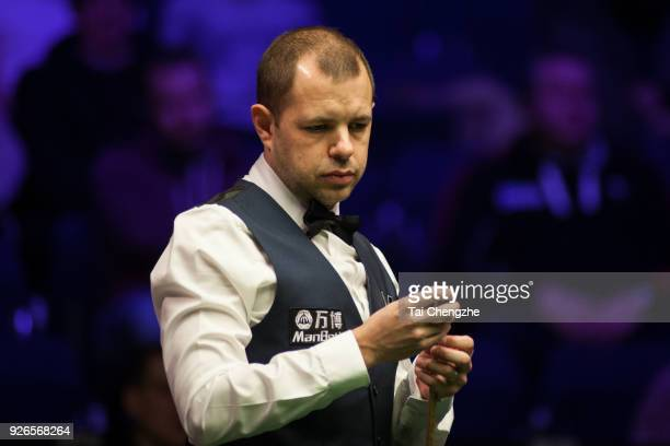 Barry S Hawkins of England chalks the cue during his quarterfinal match against Yan Bingtao of China on day five of 2018 ManBetX Welsh Open at...