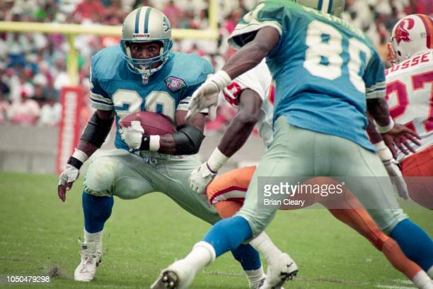 Barry Sanders of the Detroit Lions carries the ball as the Tampa Bay Buccaneers defeat the Detroit Lions in an NFL football game 2414 on October 2...