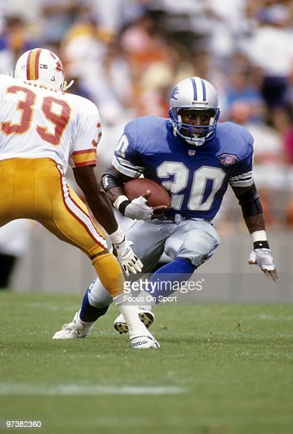 Barry Sanders of the Detroit Lions carring the ball running away from defensive back Charles Dimry of the Tampa Bay Buccaneers in a NFL football game...