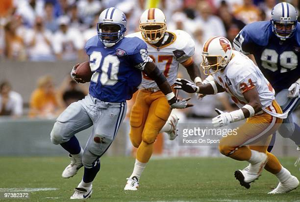 Barry Sanders of the Detroit Lions carring the ball running away from defensive back Thomas Everett of the Tampa Bay Buccaneers in a NFL football...
