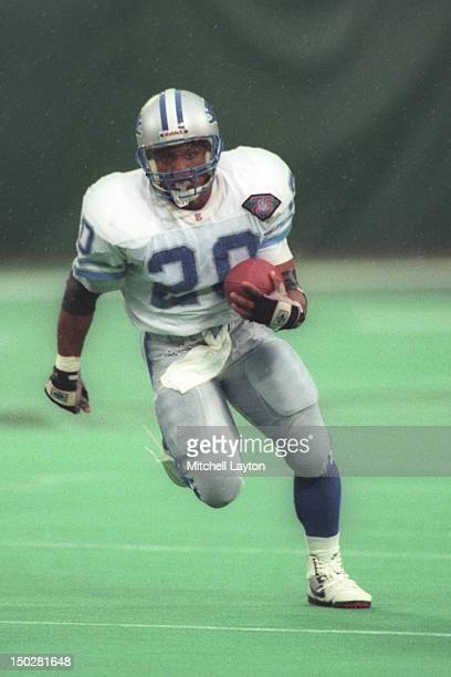 Barry Sanders of the Detroit Lions runs with the ball during a football game against the New York Jets on December 10 1994 at Giants Stadium in East...
