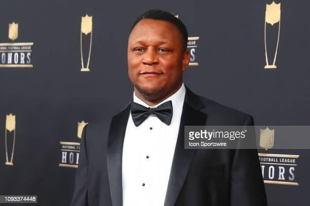 Barry Sanders poses for photos on the red carpet at the NFL Honors on February 2 2019 at the Fox Theatre in Atlanta GA