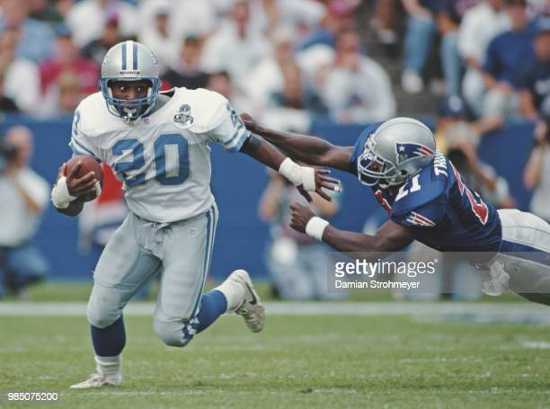 Barry Sanders, Running Back for the Detroit Lions runs the ball during the American Football Conference East game against the New England Patriots on...