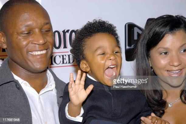 Barry Sanders with his two year old son Nigel and wife Laurn
