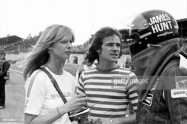 Barry Sheene and his girlfriend Stephanie McLean talking to James Hunt at a practice day for the British Grand Prix held at Brands Hatch Kent 17th...