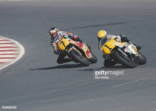 Barry Sheene of Great Britain rides the Yamaha YZR 500 alongside rival Kenny Roberts of the United States riding the Yamaha YZR 500 during the French...