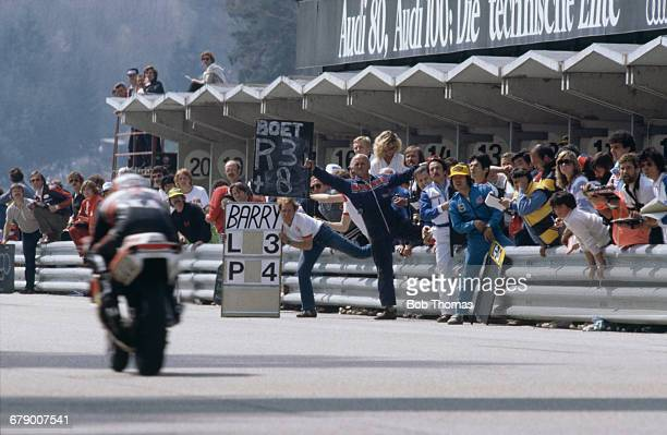 Barry Sheene's pit crew waving him instructions as he passes during the 500cc race at the Austrian Grand Prix at the Salzburgring 26th April 1981