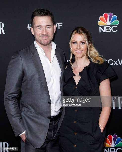Barry Sloane and Katy O'Grady attend NBC and Vanity Fair's celebration of the season at The Henry on November 11 2019 in Los Angeles California