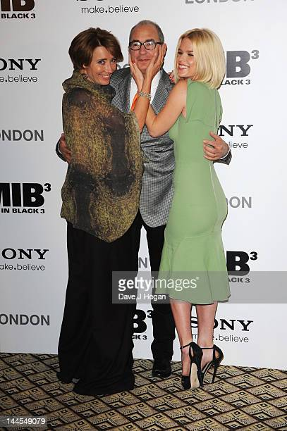 Barry Sonnenfeld Emma Thompson and Alice Eve pose at a photocall for Men In Black 3 at The Dorchester Hotel on May 16 2012 in London England