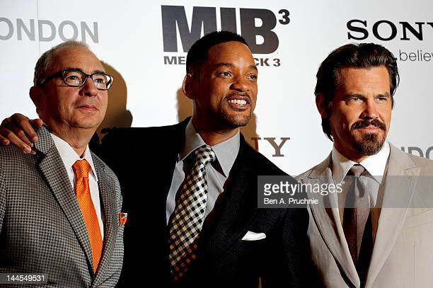 Barry Sonnenfeld, Will Smith and Josh Brolin poses for photos to promote Men In Black 3 at The Dorchester Hotel on May 16, 2012 in London, England.