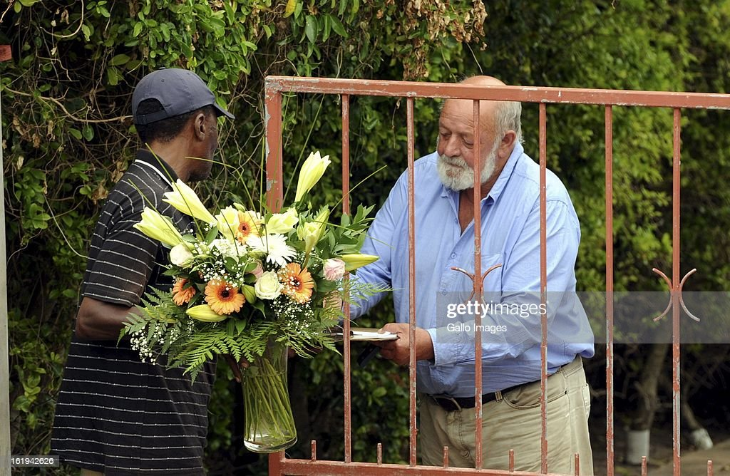 Barry Steenkamp, father to Reeva Steenkamp, receives flowers at his home in Seaview. Reeva Steenkamp was allegedly murdered by her boyfriend, Oscar Pistorius on February 14, 2013.