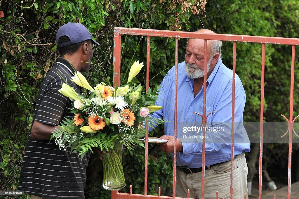 Barry Steenkamp, Reeva Steeenkamp's father, receives flowers on February 15, 2013 in Port Elizabeth, South Africa. Reeva Steenkamp was allegedly shot dead by Oscar Pistorius on February 14, 2013. She died on the spot.