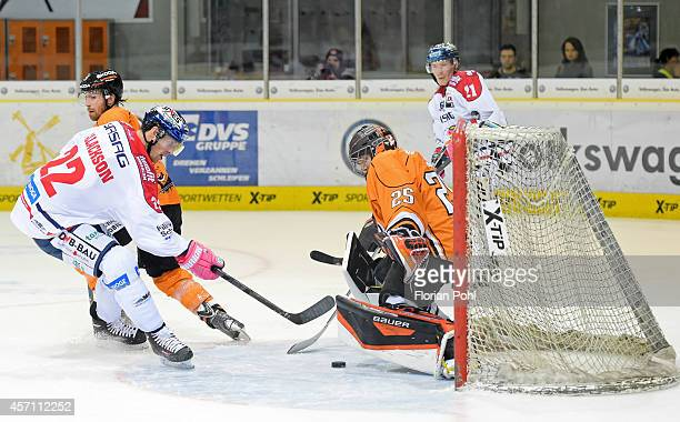 Barry Tallackson of Eisbaeren Berlin scores a goal against Sebastian Vogl of Grizzly Adams Wolfsburg during the DEL match between EHC Wolfsburg and...